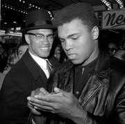 Malcolm X and newly crowned heavyweight champion Muhammad Ali are together in New York City in March 1964.