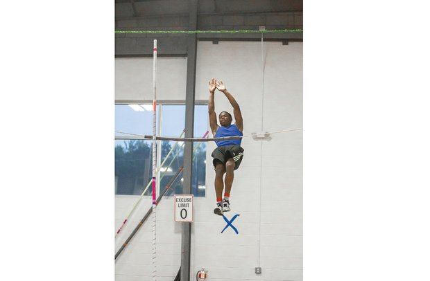 Pole vaulter Chris St. Helen practices his lift and positions at Aerial East Gymnastics in Mechanicsville. The Henrico resident won the Division 5, South Regional title last month by clearing 15-4.