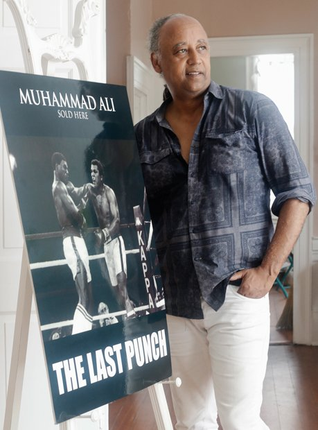 "Petersburg resident Jesse Vaughan displays poster art from ""The Last Punch,"" the feature film he directed about Muhammad Ali's final fight."