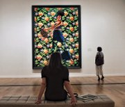 """Samantha Schwartzkopf takes in Kehinde Wiley's """"Judith and Holofernes."""""""