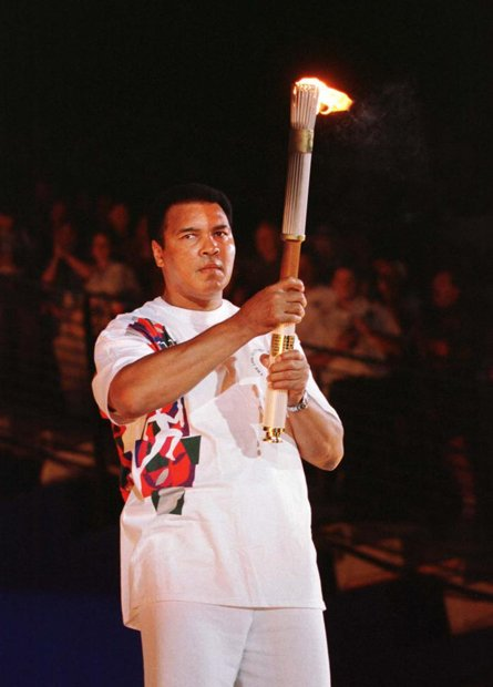 Muhammad Ali holds the Olympic torch as he prepares to light the flame and open the 1996 games in Atlanta.