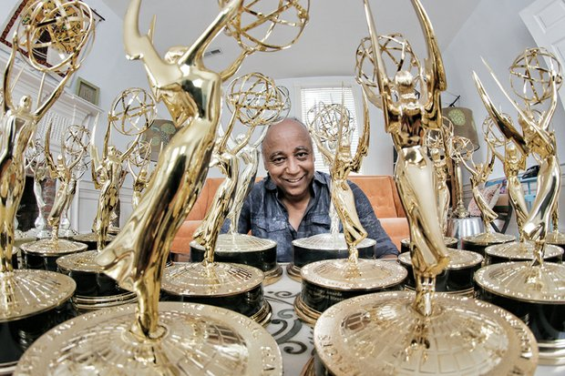 Jesse Vaughan displays the extensive collection of Emmys he has won through the years for various projects. His latest, won last Saturday, is for a documentary film on food deserts for Virginia State University, where he is director of the Advance Creative Services Group.