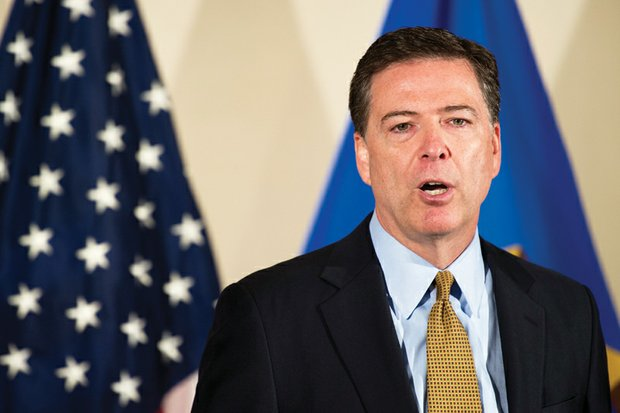 FBI Director James Comey takes no questions from reporters after issuing his statement Tuesday on the bureau's yearlong probe into former Secretary of State Hillary Clinton's private email server.