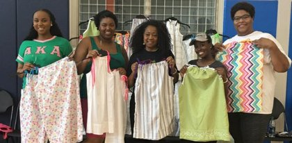 Omicron Gamma Chapter of Alpha Kappa Alpha Sorority, Inc. made 20 little dresses for Africa