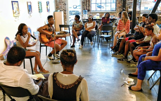 """Emporess Benniefield and Oryan Law perform """"Tears of a Nation"""" during the open mic session at ART 180's Black Lives Matter Youth Forum last Friday."""