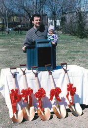 City Councilman Tim Kaine, with 11-month-old daughter Annella, at 1995 groundbreaking