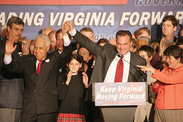Gov.-elect Kaine signals his victory on election night 2005 with former Gov. L. Douglas Wilder.