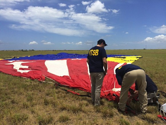 Part of the hot air balloon that crashed in Texas hit power lines when it went down, an NTSB spokesman ...