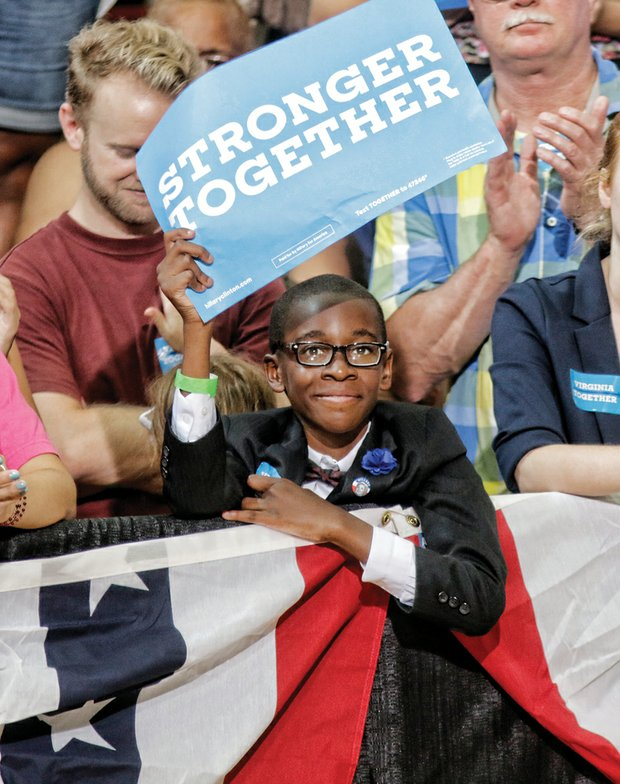 Young motivational speaker Elijah Coles Brown of Henrico County is among those cheering Sen. Kaine.