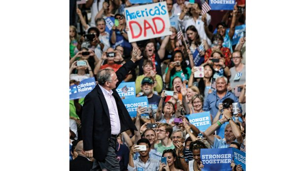 """Above, Tim Kaine declares, """"It's great to be home"""" as the Democratic vice presidential nominee receives a warm welcome Monday evening from supporters at Huguenot High School."""