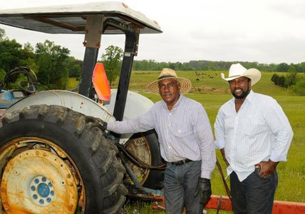 John Wesley Boyd, Jr., lives off the land raising cows, growing soybeans and corn on 400 acres he owns in ...