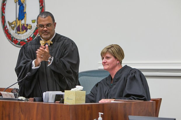 New Judge Mary Elizabeth Langer receives applause from the chief judge of the Richmond Circuit Court, C.N. Jenkins Jr. She joined him on the bench during a ceremony last Friday in which she was officially installed as a judge of the Richmond Juvenile and Domestic Relations District Court.