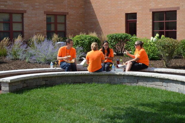 Lukancic Middle School teachers have lunch in the district's first outdoor classroom the day before classes were set to begin.