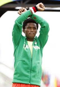 Using every fiber of his being, track star Feyisa Lilesa of Ethiopia made a dash across the finish line at ...
