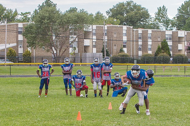 George Wythe High School's team practices Tuesday in preparation for this season's matchups against opponents from larger schools in the Richmond area.
