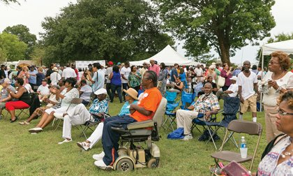 """More than 1,000 people spread out across the lawn of the Newport News family home of Rep. Robert C. """"Bobby"""" Scott for the 40th annual Labor Day event"""