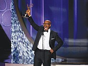 """Courtney B. Vance accepts the award for outstanding lead actor in a limited series or movie for his role as the late renowned defense attorney Johnnie Cochran in """"The People v. O.J. Simpson."""" Mr. Vance acknowledged his wife, actress Angela Bassett, in accepting the award."""