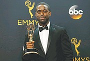 """Sterling K. Brown shows off the outstanding supporting actor in a limited series Emmy he won for a movie portraying prosecutor Christopher Darden in """"The People v. O.J. Simpson."""""""