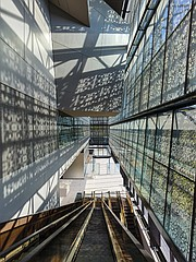 Light pours through the exterior metal panels, illuminating the interior of the new National Museum of African American History and Culture in Washington. It is the first LEED Gold certified museum on the National Mall.