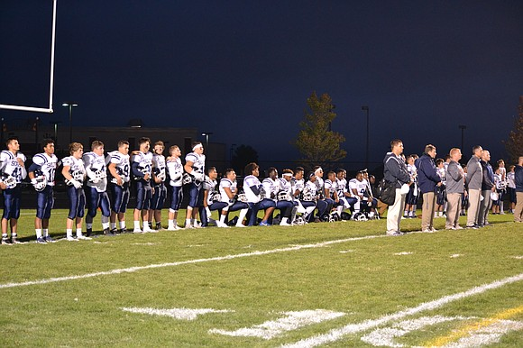 During the National Anthem at Friday's game, members of the Plainfield South football team took a knee to protest police ...