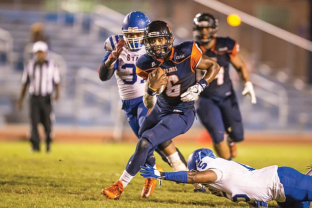 Quarterback Tarian Ayres runs the ball in to score for the Virginia State University Trojans during last Friday's home game against Elizabeth City State University. The game was played a day early because of weather concerns.