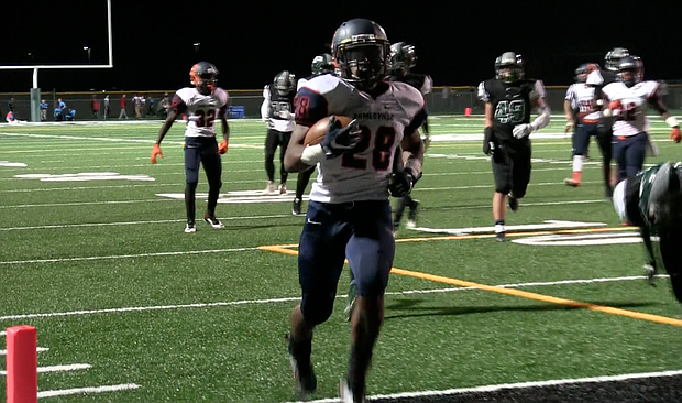 Romeoville running back Jordan Nettles (28) scores one of his four touchdowns during his team's 52-14 win over Plainfield Central.