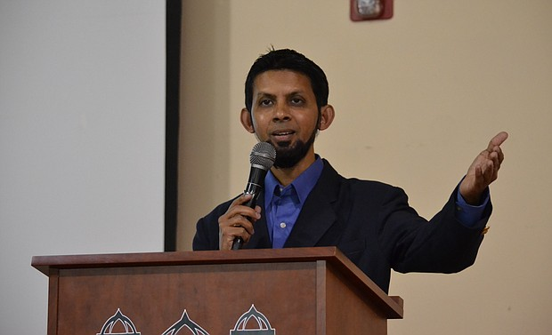 Dr. Sabeel Ahmed of Gain Peace speaks to visitors at a Bolingbrook mosque about Islam at an open house sponsored by the Muslim Association of Bolingbrook.