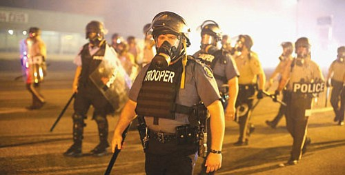 """""""Do Not Resist"""" offers a stunning look at the current state of policing in America and glimpses into the future ..."""