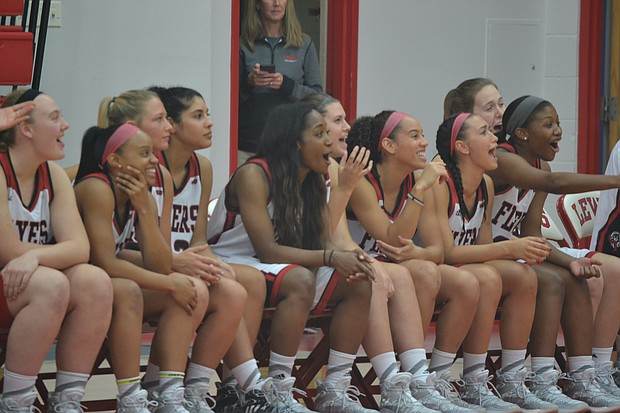 Members of the Lewis women's basketball team react to the festivities at the Fan Fest held on Oct. 20 at Neil Carey Arena.