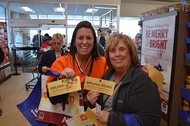 "Sisters Connie Tucker and Debbie Orr each won $100 ""golden tickets"" at the Aldi Store re-opening."