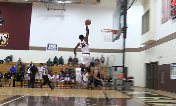 Romeoville foward Dontia Johnson (10) slams in one of his dunks during his team's 59-38 win over Lemont on Wednesday.