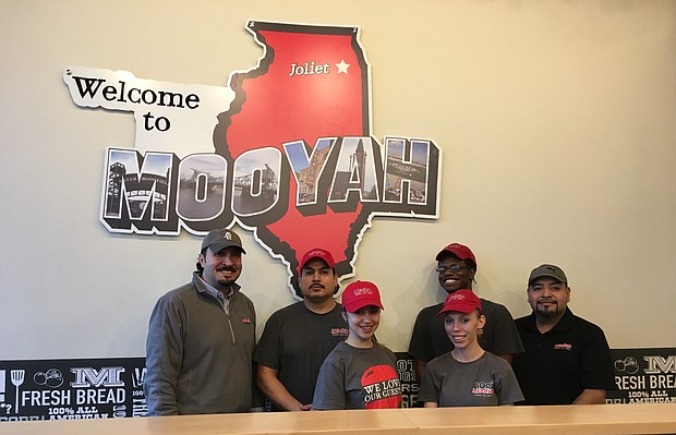 Mooyah Burgers, Fries & Shakes staff in Joliet. The franchise will be collecting food donations and giving part of its proceeds during the weekend of December 9-11 to two local charities for the holidays.