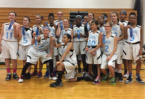 William B. Orenic Intermediate School's 6th grade girls' basketball team took the top spot in a recent conference tournament in ...