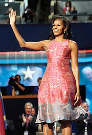 Mrs. Obama waves to delegates at the 2012 Democratic National Convention in Charlotte, N.C., sporting a rose and gray silk jacquard dress by designer Tracy Reese. Below, First Lady Michelle Obama wears a floor-length, rose gold chainmail gown designed by Atelier Versace during the October State Dinner for the prime minister of Italy and his wife.