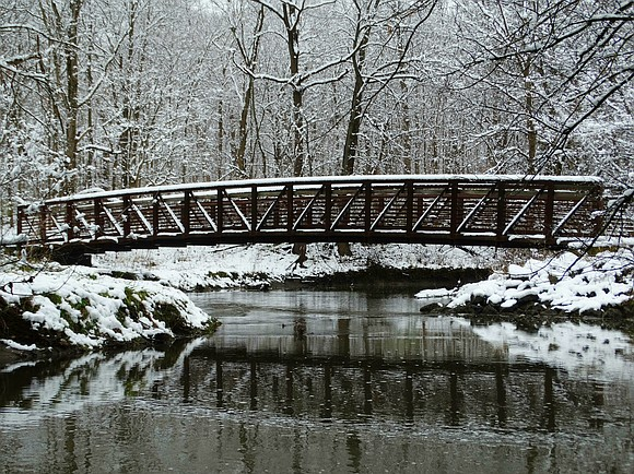 Check Medrano won the December photo contest for his entry of a snow-covered bridge.