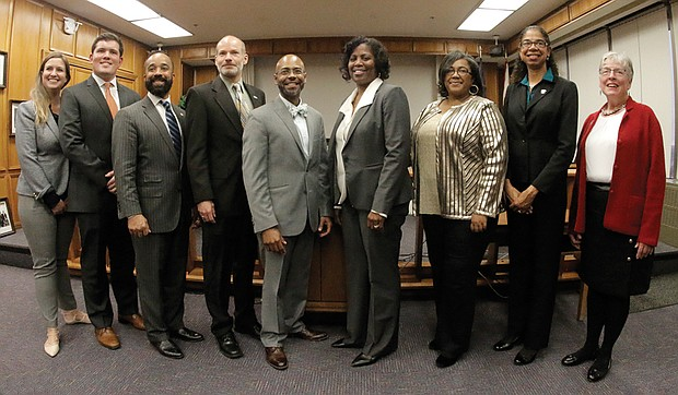 "Richmond's new School Board members pose at City Hall after their swearing-in on Tuesday. They are, from left, Elizabeth ""Liz"" Doerr, 1st District; J. Scott Barlow, 2nd District; Jeff Bourne, 3rd District; Jonathan Young, 4th District; Vice Chairman Dr. Patrick Sapini, 5th District; Chairwoman Dawn Page, 8th District; Felicia Cosby, 6th District; Nadine Marsh-Carter, 7th District; and Linda Owen, 9th District."