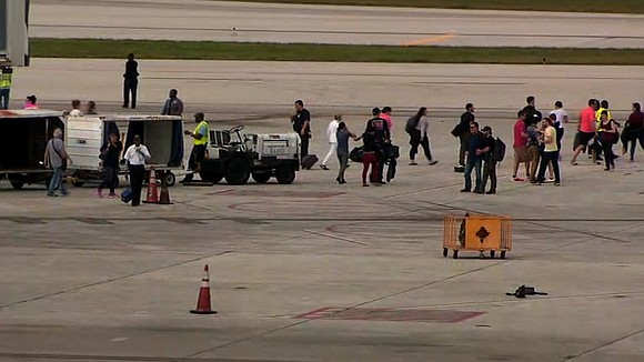 Five people were shot dead and eight wounded in the baggage claim area at Fort Lauderdale's airport, and law enforcement ...
