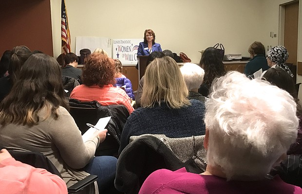 Jackie Traynere, the outgoing president of the Democratic Women of Will County, resides over the group's annual meeting on January 28, 2017 at the Fountaindale Library in Bolingbrook.