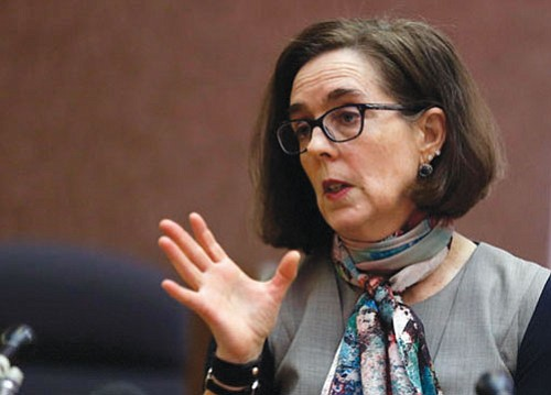 Oregon Gov. Kate Brown has signed an executive order to solidify the state's status as a sanctuary state forbidding state ...