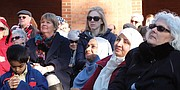 Supporters listen as U.S. Sen. Mark Warner, Congressman A. Donald McEachin of Henrico and Richmond area faith leaders call for support and solidarity for immigrants, refugees, religious freedom and diversity.