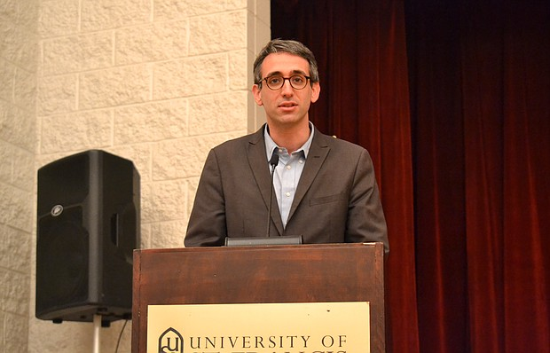 State Rep. Will Guzzardi (D-Chicago) speaks to mostly students at the University of St. Francis about making in-state tuition for Illinois junior colleges and universities free.