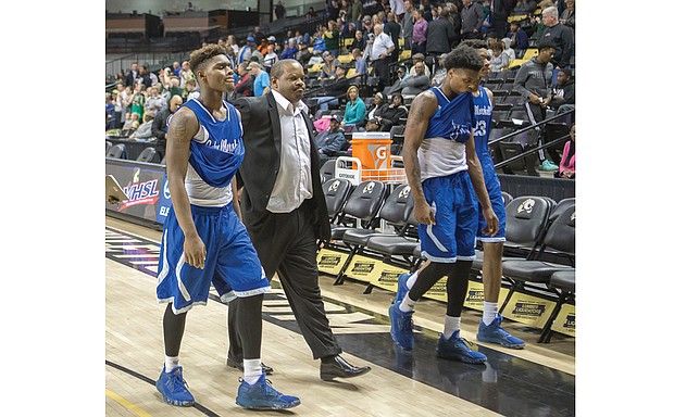 John Marshall High Coach Ty White, above, walks to the locker room with his dejected ballplayers after the Justices' 72-59 loss March 2 to Roanoke's Northside High School during a quarterfinal game at the state 3A tournament at the Siegel Center. At right, George Wythe High's Antonio Bridy snags the ball during the Bulldogs' victorious quarterfinal match against Heritage High School of Lynchburg on March 2. The Bulldogs fell to I.C. Norcom High School of Portsmouth during the semifinals on March 3.