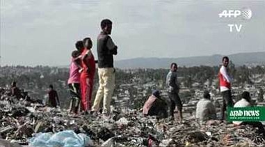 A giant landslide that crashed down on a landfill where hundreds of Ethiopians collected recyclables killed upward of 65 local ...
