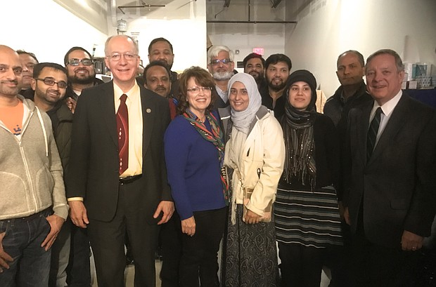 A group of Bolingbrook Muslim volunteers canvas for Jackie Traynere on March 18 and are joined by Sen. Dick Durbin and Rep. Bill Foster.