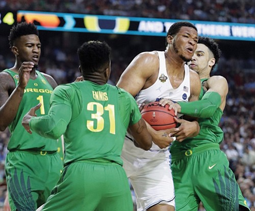Oregon struggled shooting from the perimeter and gave up two offensive rebounds on missed free throws in the final 6 ...