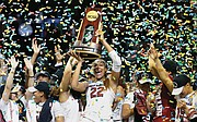 University of South Carolina forward A'ja Wilson holds the NCAA championship trophy aloft after the team's 67-55 victory in Dallas.