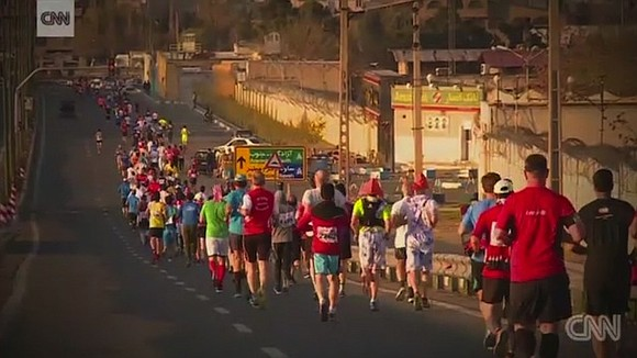 "Hundreds of runners participated in ""TehRUN"" -- the Iranian capital's first international marathon -- on Friday, but many were left ..."