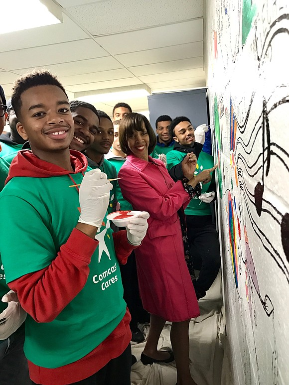 Mayor Catherine Pugh joined youth volunteers to paint a mural inside the Farring Baybrook Recreation Center
