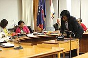 Jonnell Lilly of Harrell & Chambliss law firm dials Richmond School Board member Scott Barlow, who was in Spain, so that he could participate in the board's meeting last Friday. After the three-hour closed session, the board issued a statement the next day announcing the contract termination of Superintendent Dana T. Bedden effective, June 30.
