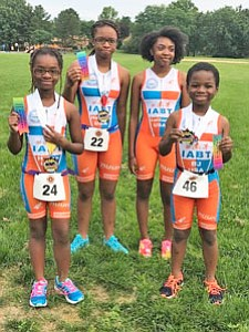 IABT junior athletes placed first, second and third in their respective age groups in a Youth Aquathon in  Columbia, Maryland in summer 2016. (Left to right) Halee (11), 3rd Place; Heaven (12), 2nd Place); Leiliani (13) is still learning to swim but came to support her teammates; and BJ (9), 1st Place..